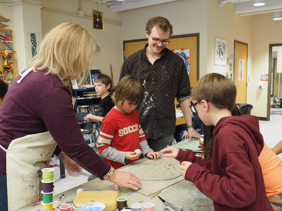 Students in the December art residency with alum Ethan Fielder test and revise their ceramic stamps.