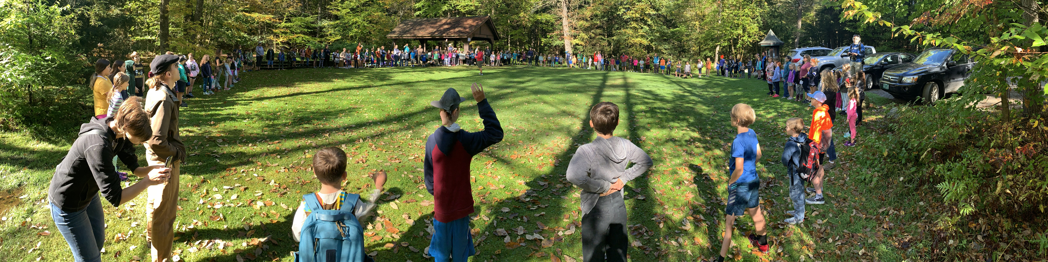 The whole school connects in a circle of dancing and drumming at Hubbard Park.